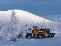 Bulldozer. Which is among the snow-covered trees in Finnish Lapland royalty free stock image