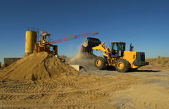 Bulldozer. Loads crushed stone into the scoop Stock Images