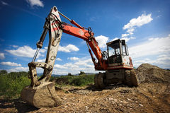 Bulldozer. In action with blue sky as background Royalty Free Stock Photo
