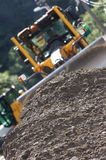 Bulldozer. Industrial machine moving gravel on a new road royalty free stock photography