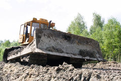 Bulldozer. A large bulldozer working on the forest. Shot from a low angle royalty free stock image