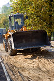 Bulldozer. The bulldozer worked for an accomplishment of foot paths in city park Royalty Free Stock Images