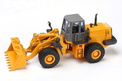 Bulldozer. The heavy building bulldozer of yellow color on a white background Stock Photo