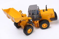 Bulldozer. The heavy building bulldozer of yellow color on a white background Stock Image
