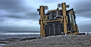Bulldozer. A Bulldozer working on the beach stock images