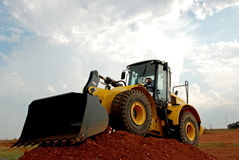 Bulldozer. Image of bulldozer equipment on mound Stock Photos