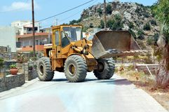 A bulldozer across the road. Royalty Free Stock Image
