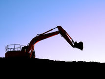 Bulldozer al tramonto Fotografia Stock