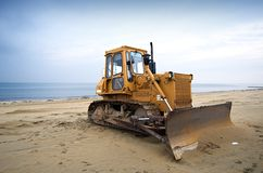 Bulldozer on the beach Royalty Free Stock Image