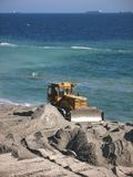 Bulldozer on the beach Stock Photos