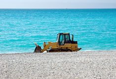 Bulldozer on the beach Royalty Free Stock Images