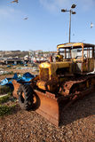Bulldozer beach fishing industry Stock Images