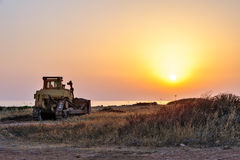 Bulldozer on the beach Royalty Free Stock Photography