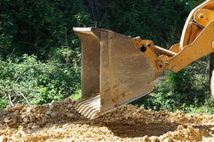 Bulldozer blade in action Stock Photo