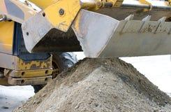 Bulldozer bucket collecting sand Royalty Free Stock Photo