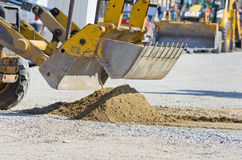 Bulldozer bucket collecting sand Royalty Free Stock Photography