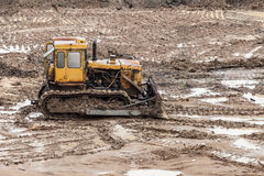 Bulldozer at building construction site Stock Photography