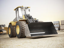 Bulldozer on a building construction site. Royalty Free Stock Photo