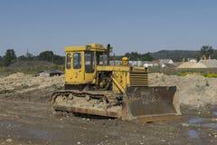Bulldozer at building construction site Stock Photos