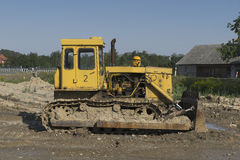 Bulldozer at building construction site Stock Image