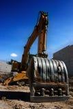 Bulldozer building dreams. Closeup picture of a shovel from a bulldozer Royalty Free Stock Photo