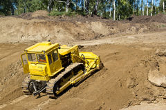 Bulldozer on a building site Stock Photography