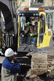Bulldozer and building workers Stock Images