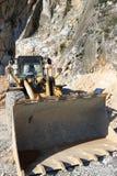 Bulldozer in a Carrara marble quarry. A large  mechanical shovel stock photos