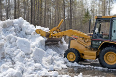 Bulldozer clearing snow Stock Images