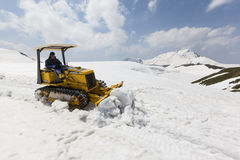 Bulldozer clears snow on Mount Tateyama, Japan Stock Images
