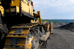 Bulldozer at a coal mine. Industrial image of construction equipment.  Bull-dozer shown at a coal mine Stock Image