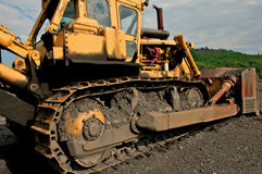 Bulldozer at a coal mine. Industrial image of construction equipment. Bulldozer shown at a coal mine Royalty Free Stock Images