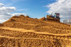 The bulldozer conducts earthworks at the construction site royalty free stock photo