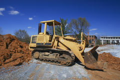 Bulldozer at construction site. Bulldozer at the site of a new bridge being built royalty free stock image