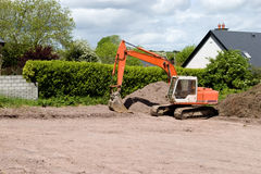 Bulldozer, Construction site. Bulldozer rests at site of home construction Royalty Free Stock Image
