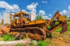 Bulldozer on construction site beneath cloudy sky Stock Image