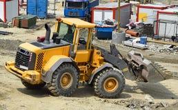 Bulldozer at the construction site Stock Photos
