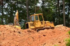 Bulldozer at construction site royalty free stock images