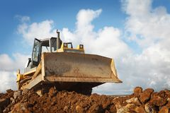 Bulldozer at construction site Stock Images