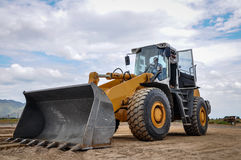 landscape photo of wheel loader in construction site royalty free stock image