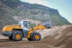 landscape photo of wheel loader in construction site royalty free stock photography