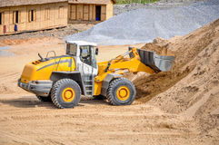 landscape photo of wheel loader in construction site stock photos