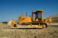 Bulldozer on construction site. Side view Royalty Free Stock Photography