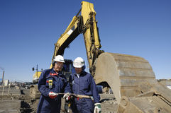 Bulldozer and construction workers Royalty Free Stock Images