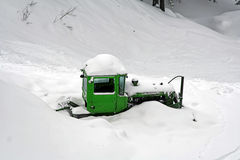 Bulldozer covered with snow Stock Photography