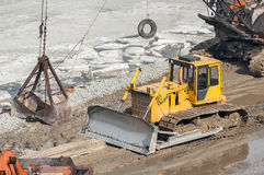 Bulldozer and crane on construction site Stock Photo