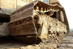 Bulldozer del trattore a cingoli nel cantiere durante dei bivi Fotografia Stock Libera da Diritti