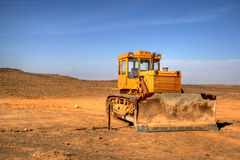 Bulldozer in the desert. Bulldozer used for heavy-duty work in the Gobi Desert Royalty Free Stock Photos