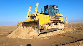 Bulldozer in the desert stock video footage