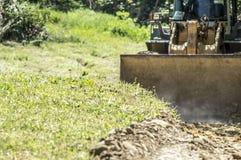 Bulldozer destroys meadow Royalty Free Stock Photography